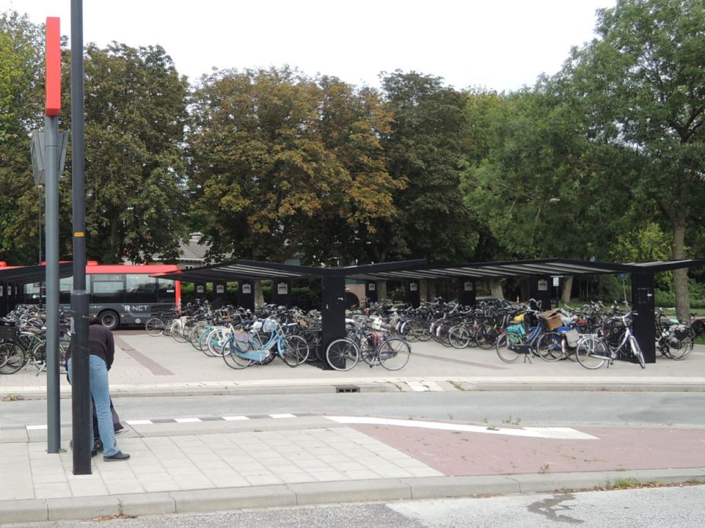 This is one half of the bike parking area at a bus station of town about six miles from downtown.
